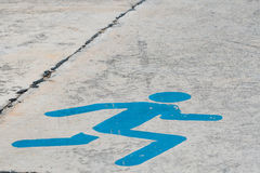 Running sign on concrete road Stock Images