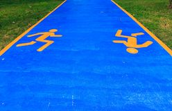 Running sign on the ground in the park. royalty free stock photo
