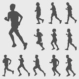 Running silhouettes  set. Black running silhouettes  set on gray background Royalty Free Stock Images