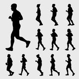 Running silhouettes  set. Black running silhouettes  set on gray background Stock Images