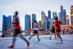 Running Singapore. People runing in the evening in Singapore Stock Image