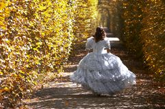 Running sissi. A young female dressed like the austrian Empress Elisabeth in fine monarchy syle Stock Images