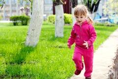 Running small girl Stock Image