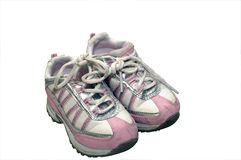 Running Sneakers. Young child's pink and white running sneakers showing wear Stock Photos