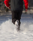 Running in the snow. Feet of a runner in the snow Stock Images
