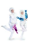 running snowmen arkivfoto