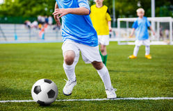 Running Soccer Player. Children Football Soccer Match. Kids Play Football Royalty Free Stock Photography