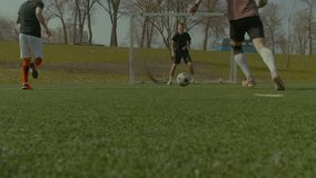 Running soccer players in action during match stock video footage