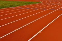 running spår för bakgrund Arkivfoton