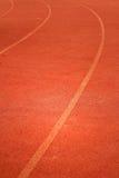 Running spår för idrottsman nenar Arkivfoton