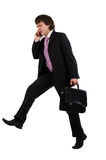 Running and speaking by phone Royalty Free Stock Photos