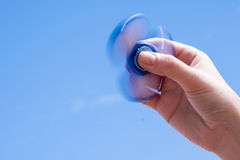 Running spinner toy Stock Images