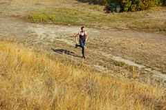 Running sport. Man runner sprinting outdoor in scenic nature. Fit muscular male athlete training trail running for. Marathon run. Sporty fit athletic man Royalty Free Stock Photo
