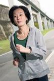 Running sport mature woman of Asian Stock Image