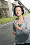 Running sport mature woman of Asian Stock Images