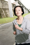 Running sport mature woman of Asian Royalty Free Stock Images