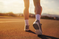 Running sport shoes on runner. Legs and running shoe closeup Stock Images