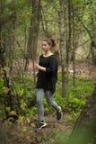 running sportigt kvinnabarn arkivfoto