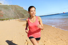 Running sports athlete runner woman on beach Royalty Free Stock Photography