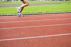 Running on sports-ground Royalty Free Stock Photography