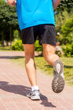 Running in sports shoes. Royalty Free Stock Image