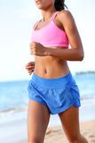 Running - Sporty Woman Runner Jogging On Beach Stock Photos