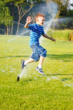 Running from sprinkles Royalty Free Stock Photography