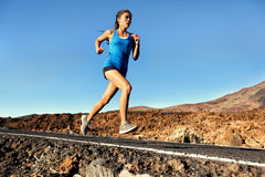 Running sprinting woman - female runner training Stock Photos