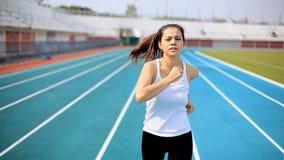 Running on stadium track. Woman running on stadium track stock footage
