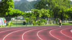 Running a Stadium track stock footage