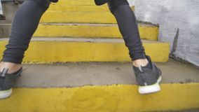 Running stairs - man runner sprinting up staircase in HIIT run exercise. Fit male athlete exercising sprint up stairway.  stock video footage