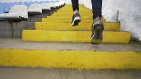 Running stairs - man runner sprinting up staircase in HIIT run exercise. Fit male athlete exercising sprint up stairway.  stock footage