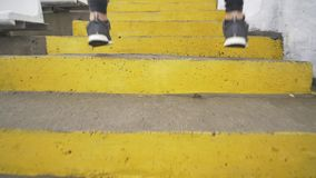 Running stairs - man runner sprinting up staircase in HIIT run exercise. Fit male athlete exercising sprint up stairway.  stock video