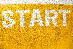 Running start signs painted on the road, good place for healthy royalty free stock photography