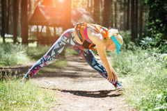 Running stretching. Woman stretching leg as warm-up before run w Royalty Free Stock Photos