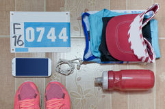 Running stuff laid out ready for a race day. Soft focus. Stock Photography