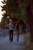 Running at sunset. Two young women running at sunset Royalty Free Stock Photo