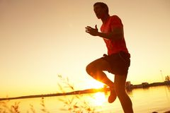 Running on sunset stock photography