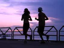 Running at sunset Royalty Free Stock Photo