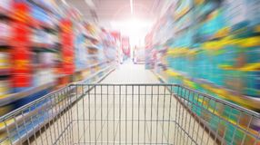 Running after supermarket promotions Stock Image