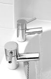 Running taps. Running chrome taps into bath Stock Images