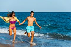Running teen couple. Royalty Free Stock Photo