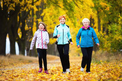 Running. Three generations of women running in park Stock Image