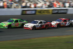 Running thru turn 4 in NH. J.J. Yeley, Kasey Kahne and Robbie Gordon racing at New Hampshire International Speedway to start the 2007 Chase for the Nextel Cup Stock Photography