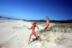 Running to the beach. Two little girls running to the beach Royalty Free Stock Photography
