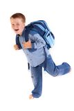Running to school. A boy with school case is running to school - studio photo - isolated on white Stock Photo