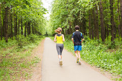 Running together - friends jogging in park Royalty Free Stock Photos