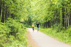 Running together - friends jogging in park Royalty Free Stock Photography