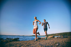 Running together Royalty Free Stock Image