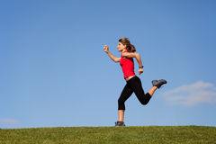 Running at the top of the hill Stock Photography